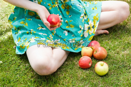 close up of girl holding apple