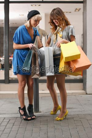 young women walking with shopping bags