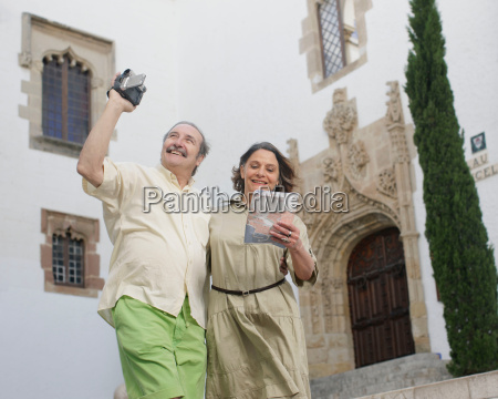 retirees taking video and looking at