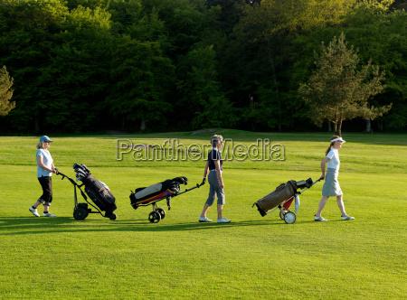 three women on a golf fairway