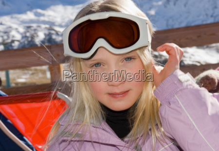 girl looking to camera wearing goggles