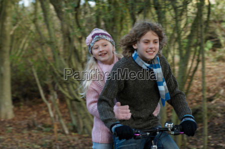boy and girl sharing bike in