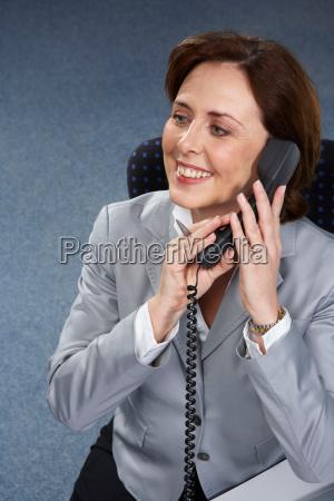 mature businesswoman on phone smiling