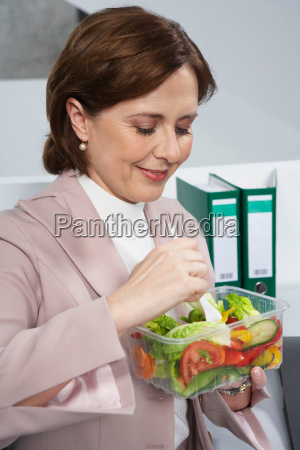 business woman eating salad