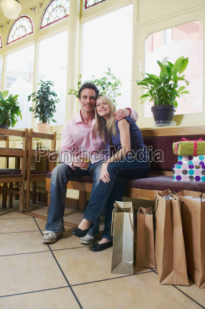 couple relax in pub after shopping