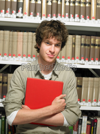 portrait of young man with book
