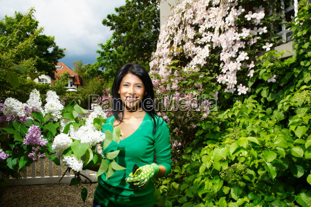 woman gardening and smiling