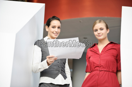 businesswomen looking at paperwork