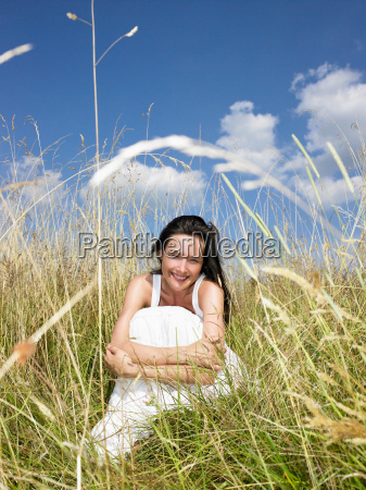 woman, seated, in, a, field, , - 18350490