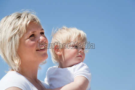 mother holding son