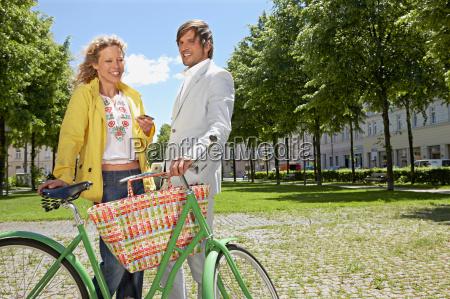 man and woman having lunch break