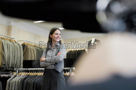 woman in clothing store looking around