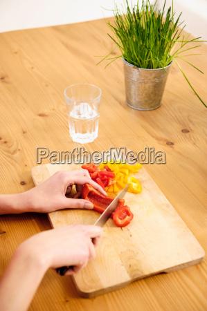young woman at home preparing food