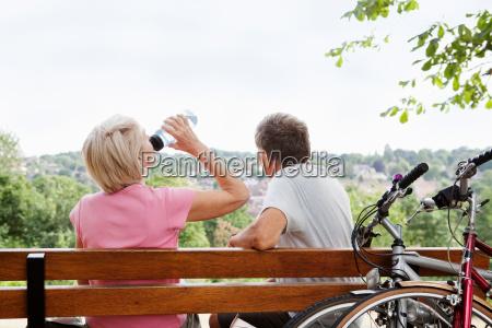 mature couple having rest on parkbench