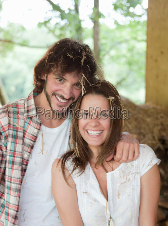 man and woman in hay barn