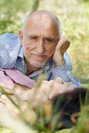 romantic older couple in long grass