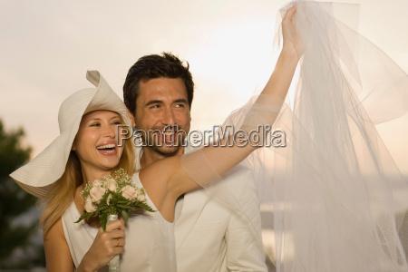 bridal couple having fun