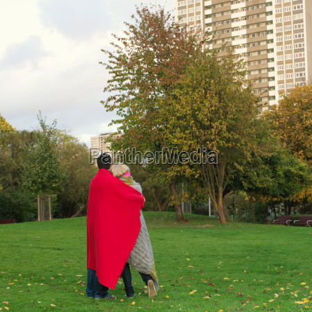 couple with blankets in the park