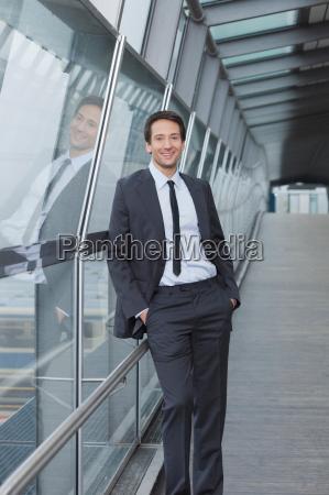 businessman at window pane total view