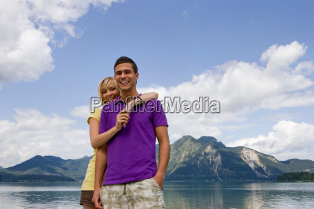 a young couple smiling towards camera