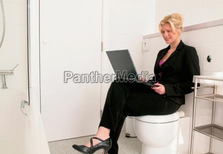 business women works in bathroom