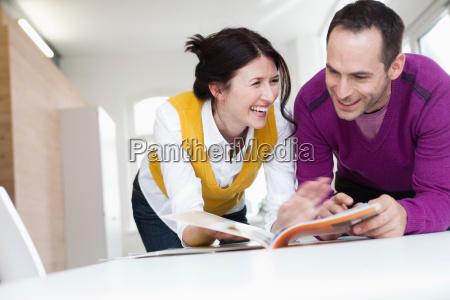 couple reading magazines