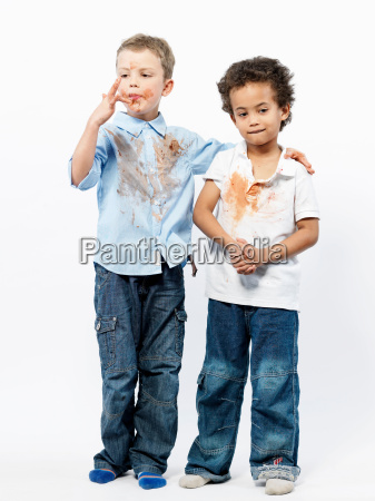 two boys playing with jam