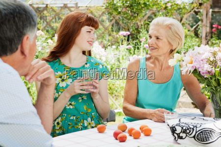 woman talks with mature couple in