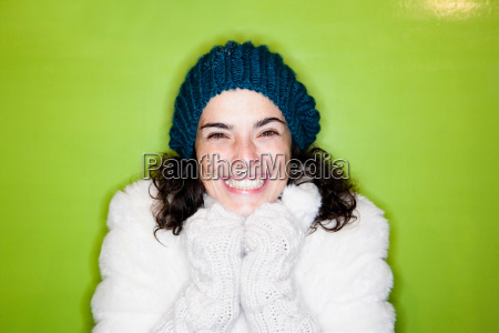 woman in front of green wall