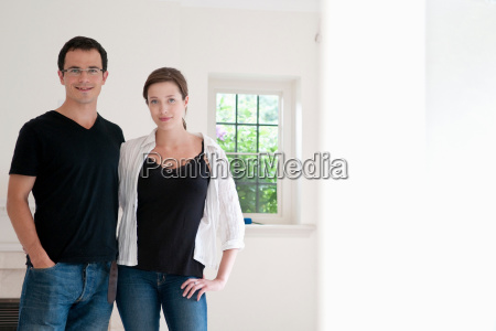 happy couple in bright new home