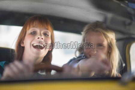 women having fun driving a car