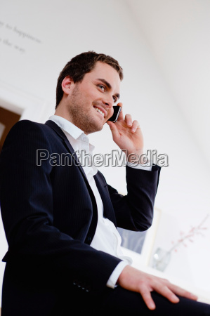 smiling man using cell phone