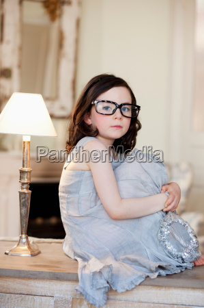little girl wearing huge pair of