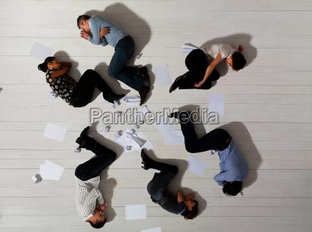 business men and women asleep on