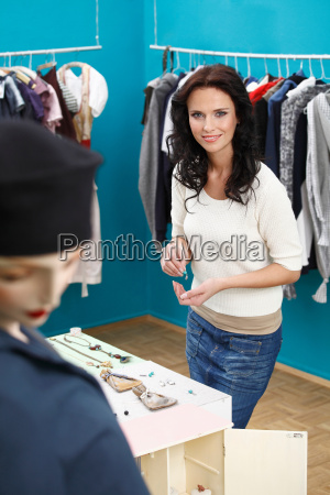 portrait of woman in clothes shop