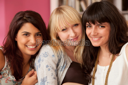 three young women looking to camera