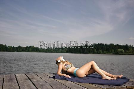 young woman lying on blanket relaxing