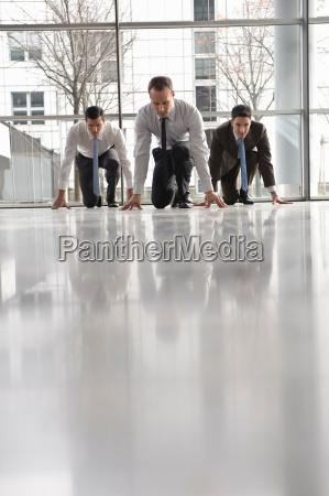 business men at start position waiting