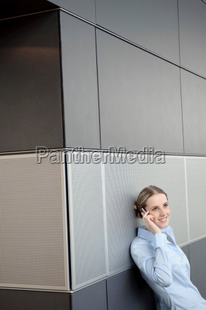 business woman using mobile in office