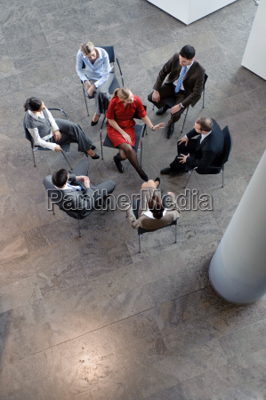 group of people sitting in circle