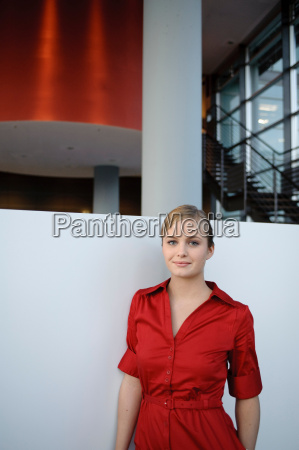 young businesswoman in red dress