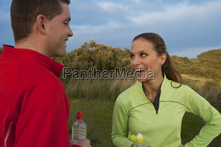 young smiling couple drinking water