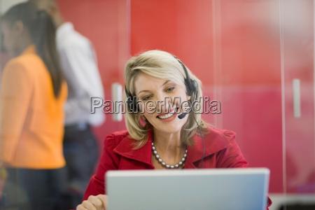 businesswoman on headset using laptop