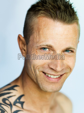close up of smiling mans face