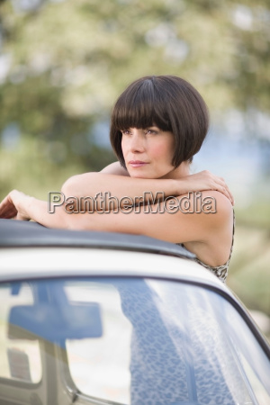 woman leaning on a car