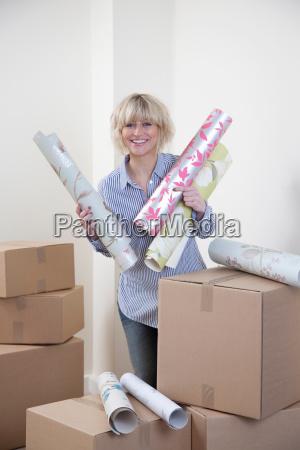 woman holding wallpaper samples