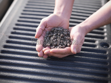 close up of man holding heap