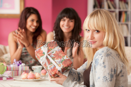 young women giving presents