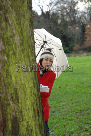 girl in red jacket with umbrella