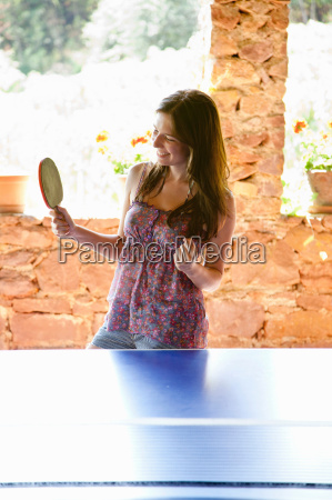 woman playing table tennis